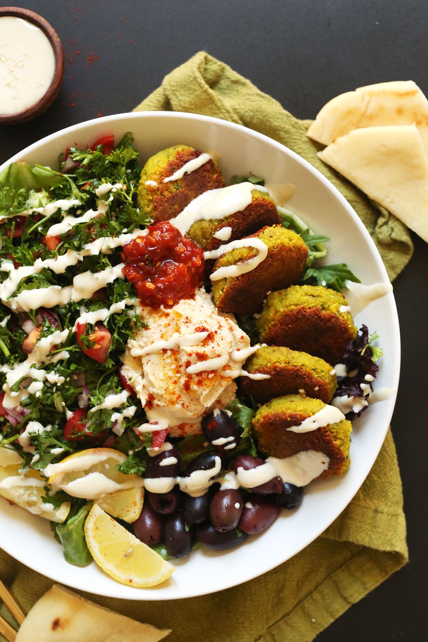 The-ULTIMATE-Mediterranean-Bowl-with-hummus-falafel-tahini-sauce-olives-and-pita-vegan-glutenfree-falafel-recipe-healthy-easy